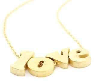 quadruple block character necklace