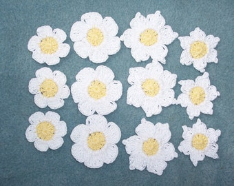 12 crochet applique flowers with yellow centers and white petals--  172