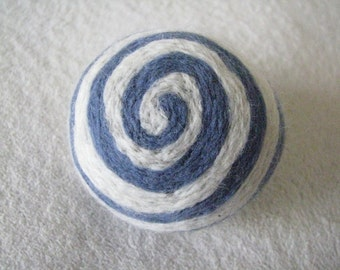 One multi-colored felted pin-cushion, Blue and White
