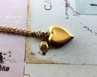 leaf. locket necklace. gold ox