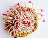 freeform crochet brooch ochre ecru pink mauve beads