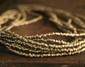 Strands of gold beads, cluster glam layered necklace