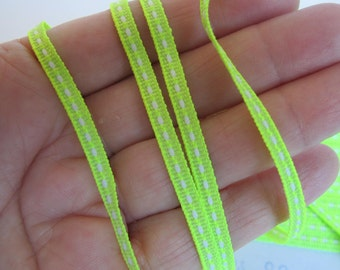 4 yards EMBROIDERED DASH twill tape. White on Neon Lime green. 3/16 inch wide. 302-12