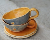 Set of 2 ceramic teacups with plates. Yellow and orange with grey and a little heart. Tableware. Dishware. Tea time.