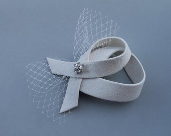 Ivory fascinator with crystal button and veiling bow