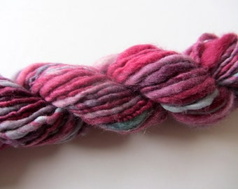 Raspberry.  Handspun Merino varying texture- 1 ply