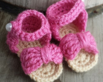 Crochet baby bow sandals pink and tan size 0-3 mo.  With pearl button closure