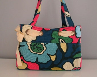 Large shoulder handbag fashioned in vibrant floral fabric, ribbon detail