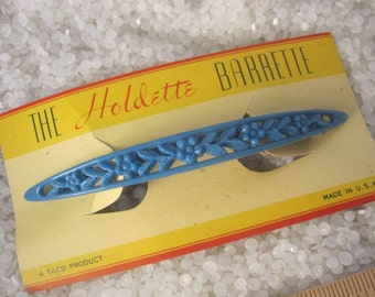 Large vintage barrettte ,slender row of flowers, bright blue, still on store card