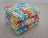 Crochet Dish Cloths in Cotton. Rose Pink, Sky Blue, Sunny Yellow, and White.