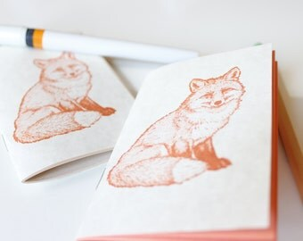 tiny fox notebook journal sketchbook. rusty orange fox on parchment colored cover. for recording your foxiest ideas. pocket size.