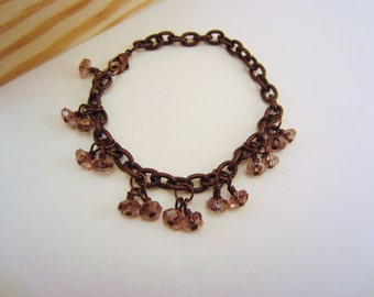 Pink and brown bracelet. Copper link bracelet with lavender purple glass beads. Wire-wrapped beads. Mixture of industrial and elegant.
