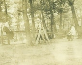 See Saw Teeter Totter Playground Ride Young Women Sitting Sideways in Dresses Sepia Antique Vintage Black and White Photo Photograph