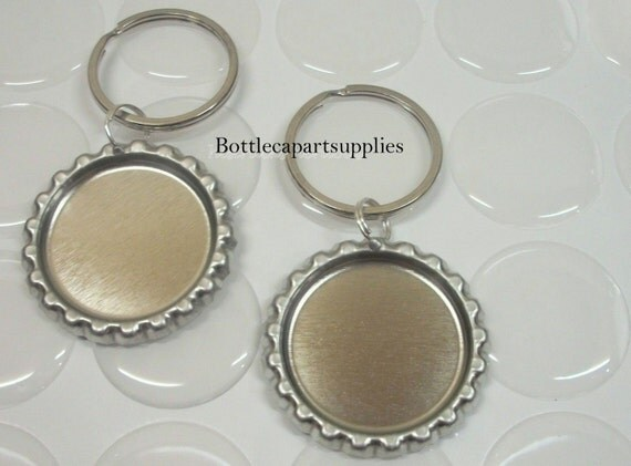 """25 FLAT Silver Linerless Bottle Cap KEYCHAINS Charms Epoxy Sticker Kit.   Complete with 25  1"""" Resin Dome Epoxy Stickers"""
