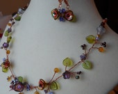 Flower necklace,rich, warm colors,copper wire,deep rusts,topaz,amber,lavender,and purple glass flower beads & leaves,  seed beads
