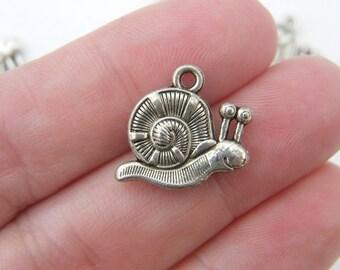 8 Snail charms tibetan silver A205