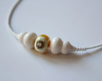 White coral and crab fire agate stone pendant with tiny white beads