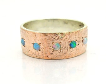 Opal ring with hammered holes rose gold & silver