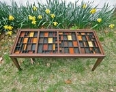 Handmade coffee table with inlaid colored blocks. Letterpress type trays are altered, combined and finished to become the top of the table.