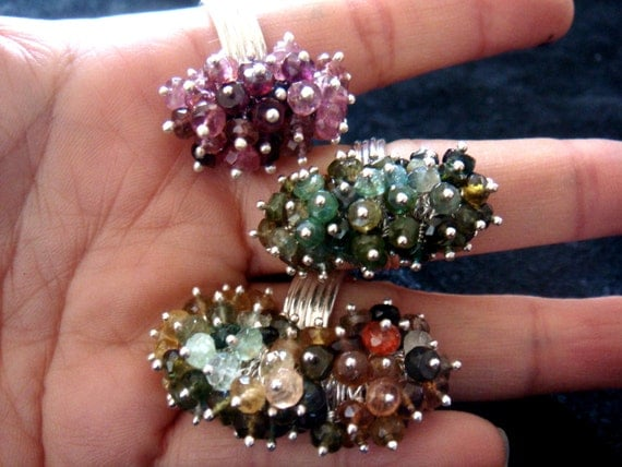 pink gemstone cluster ring, green gemstone, blue gemstone too, CATERPILLAR, tourmaline cluster ring with rainbow colour tourmalines