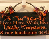 A Witch Lives Here with Her Little Monsters and One Handsome Devil- Halloween Sign with cast iron scroll on top