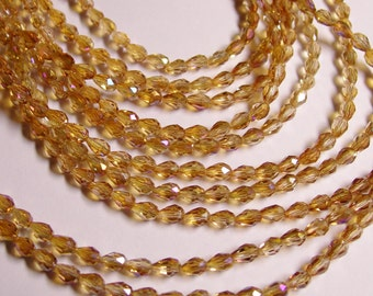 Faceted teardrop crystal beads - 100 pcs - 3mm x 5mm -  ab finish - dark golden topaz - CLGD23