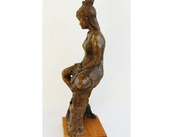 Sitting high, an original bronze sculpture
