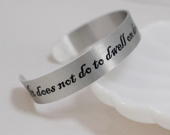 """It does not do to dwell on dreams and forget to live 1/2"""" aluminum cuff"""