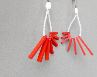 tribal geometric hoop earrings with red sticks and white beads , contemporary jewelry