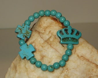 Turquoise-colored Magnesite Stretch Bracelet with a Crown and Two Equilateral Crosses