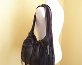"""black leather handbag, shoulder purse, with flower rose, fringe and ruffle by Tuscada. Reserved for """"E""""."""