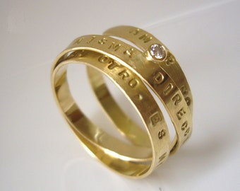 Engagement/wedding ring with text and diamond