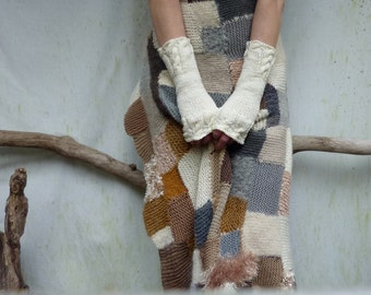 Highlander Warmers in creamy white, hand knitted merino wool fingerless gloves with cable detail