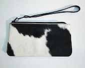 Black and White cow print fur wristlet