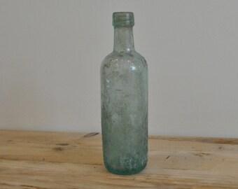 R. White large aqua glass bottle - Rough surface - Worn - Decorative vase