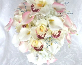 Pink and white calla lily cascade bouquet with white cymbidium orchids