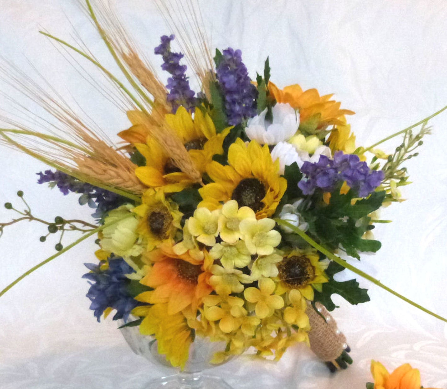 Rustic wedding bouquet made with sunflower and wheat