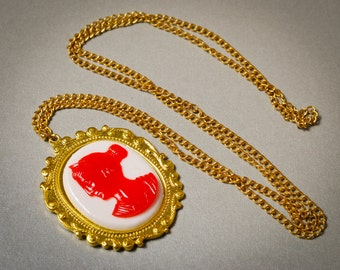 Vintage cameo necklace on brass chain . Woman face
