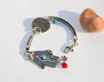 Hamsa Bracelet with s Silver prayer coin .