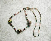 Gold beaded Dragon Necklace with coral, black onyx and malachite