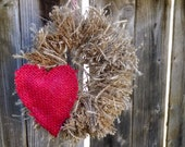 Hanging burlap wreath with burlap heart