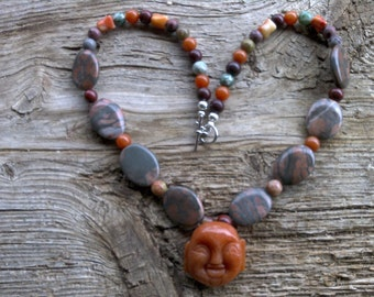 Carnelian buddha,canyon marble,misc. stone beaded necklace 21 inch