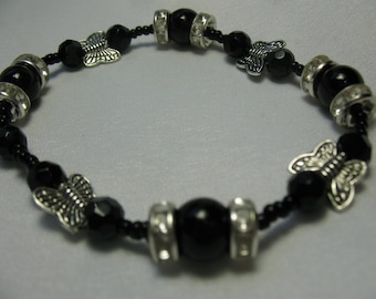 Black crystal and onyx with silvery butterfly bracelet.