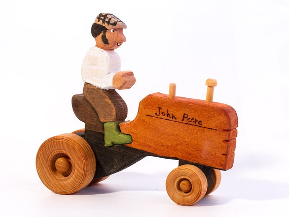 Pete the farmer on his tractor / wooden toy tractor