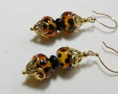 Crazy Cheetah spotted lampwork glass beaded gold earrings....
