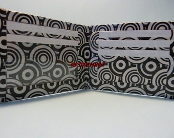 hand made duct tape wallet with a graphic swirl all over it