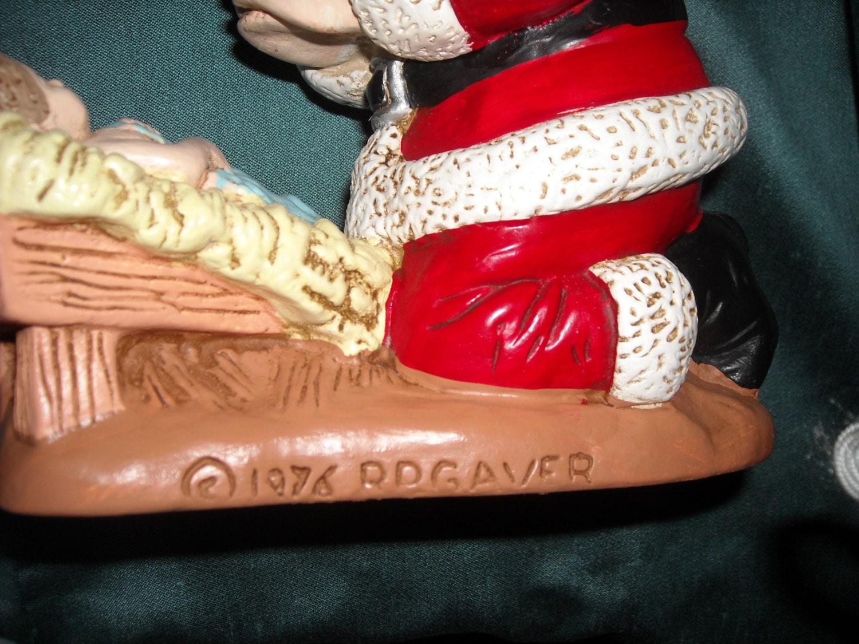 Kneeling Santa And Baby Jesus