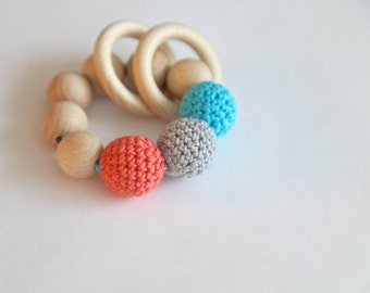 Teething toy with crochet beige, cyan/aqua, coral wooden beads and 2 wooden rings. Wooden rattle. Teething ring