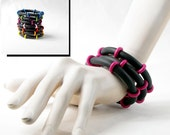 Beaded rubber bracelets with bright pink wooden beads Model Diane