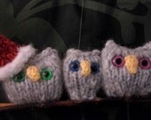 READY TO SHIP Hand knit family of holiday owls perched atop a branch of holiday yarn balls.